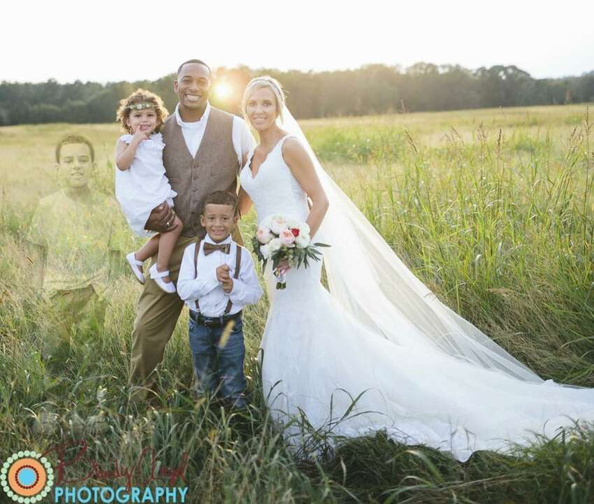 A ghostly image of Anna Bozman Thompson's son, Lake, who died of leukemia six months ago, was photoshopped in her family wedding photo.