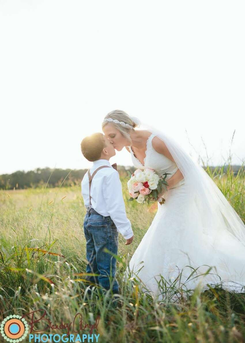 Anna Bozman Thompson kisses her younger son during her wedding photo shoot.
