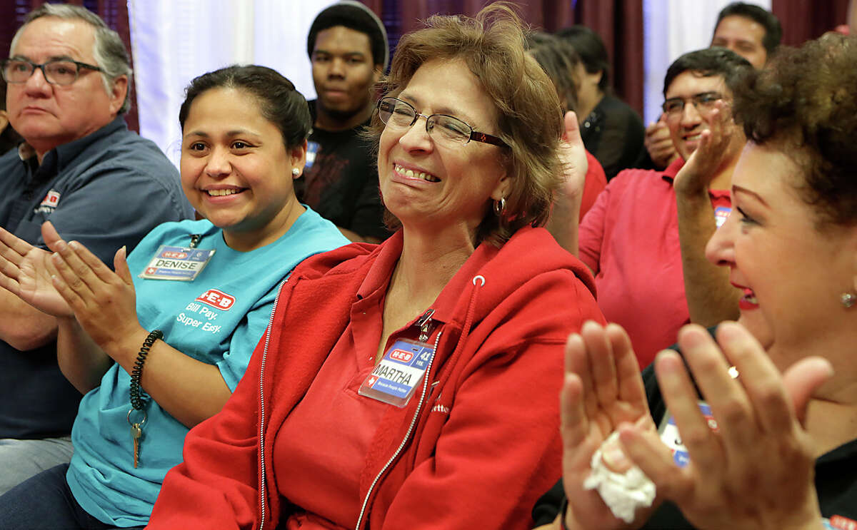 Martha Vallejo, center, who has worked for H-E-B for 41 years, is overcome with joy when she thinks about the finances she will benefit from as H-E-B announces their Partner Stock Plan in the company on Monday, November 2, 2015, at the H-E-B Market Place on Bandera Rd at 410. At right is Jo Ann Arguijo and at left is Denise Cantu.