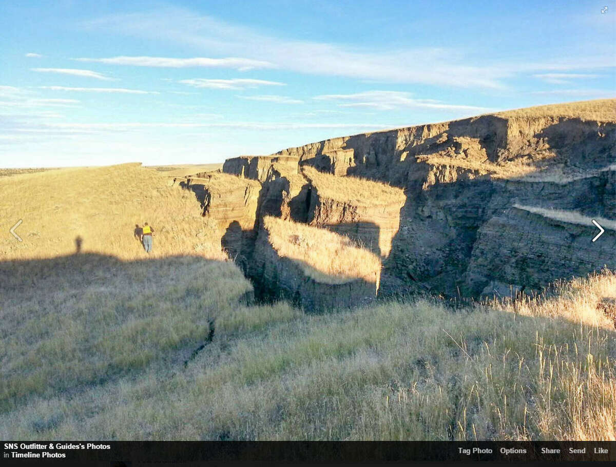 """Guides with SNS Outfitter & Guides in Wyoming found a crack last month that has grown into what's been referred to as """"the gash.""""Click through the gallery for more images of this sinkhole and recent sinkholes around the world."""