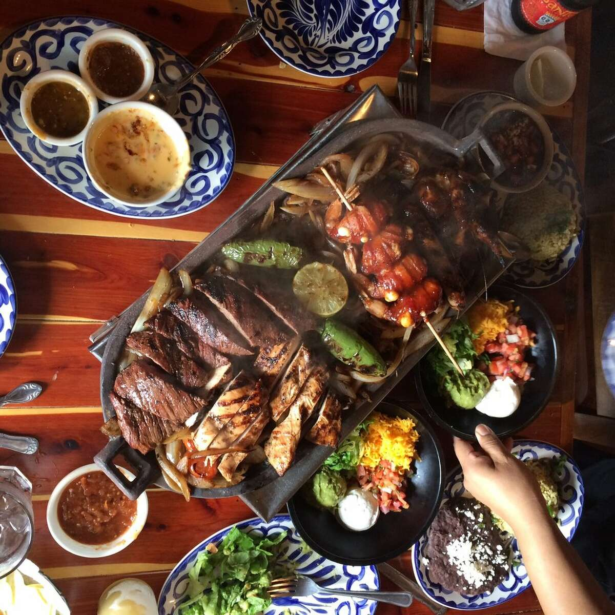 Parrillada (beef and chicken fajitas, glazed quail and shrimp brochette) at Skinny Rita's Grille, 4002 N. Main, Houston. Skinny Rita's Grille will open a second location in December 2015 at 607 W. Gray.