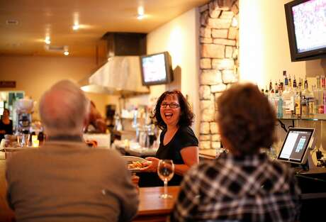 Suzie Stephenson laughs with customers at Boar's Breath in Middletown, Calif., on Saturday, October 24, 2015. Photo: Sarah Rice, Special To The Chronicle