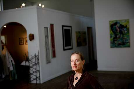 Lisa Kaplan, co-founder of the Middletown Arts Center, in the space in Middletown, Calif., on Saturday, October 24, 2015. The space is now being used as a meeting space, and for classes, while clothes (at left) are available for community members affected by the fire. Photo: Sarah Rice, Special To The Chronicle