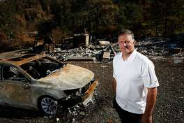 Duane Harper, the general manager of Hardesters Hardware, lost his home in the fire. He is photographed at the site where his house used to be at Cobb, Calif., on Saturday, October 24, 2015. Harper reopened the store as soon as possible and allowed people to pay on the honor system.