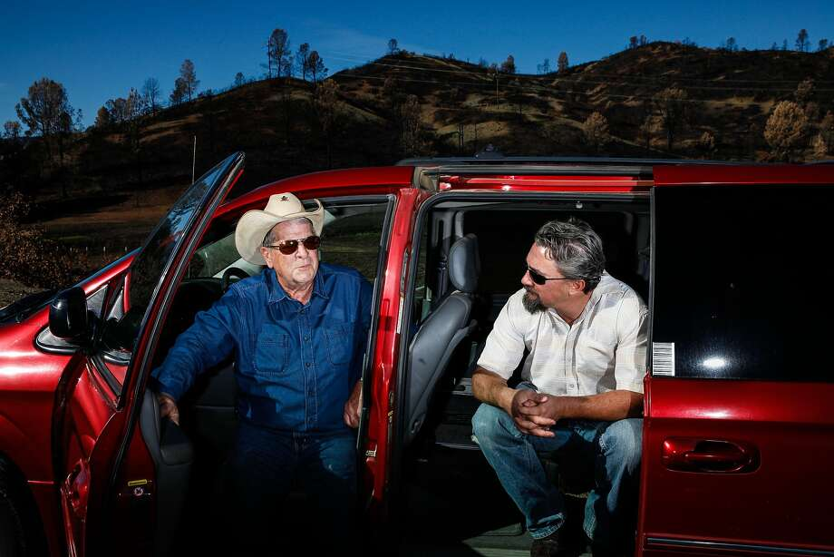 Jack Saylor, left, picked up Dan Tyrrell (cq), right, on the side of Highway 29 not far from this spot after his truck caught fire during the evacuation in Hidden Valley, Calif., Monday, October 26, 2015. They then fled in heavy smoke and fire down Highway 29. Photo: Sarah Rice, Special To The Chronicle