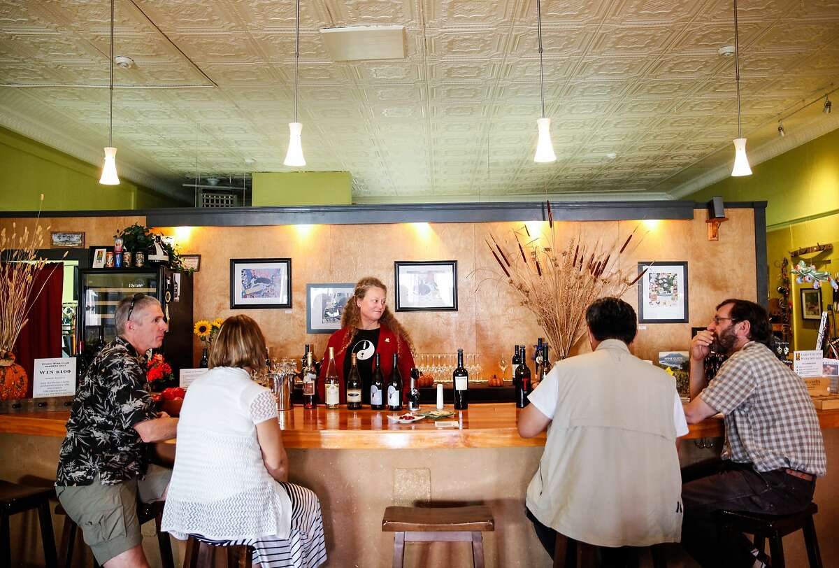Susan Feiler, the owner of Lake County Wine Studio, pours wine for guests in Upper Lake, Calif., Monday, October 26, 2015.