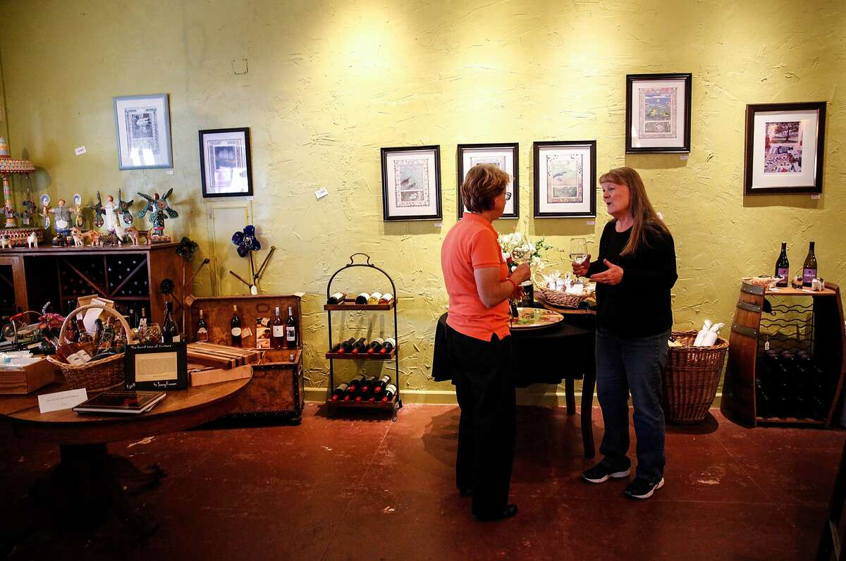 Shirley Morse, right, and Kelly Palmer-Burns, left, both of Upper Lake, taste wine at Lake County Wine Studio in Upper Lake, Calif., Monday, October 26, 2015.