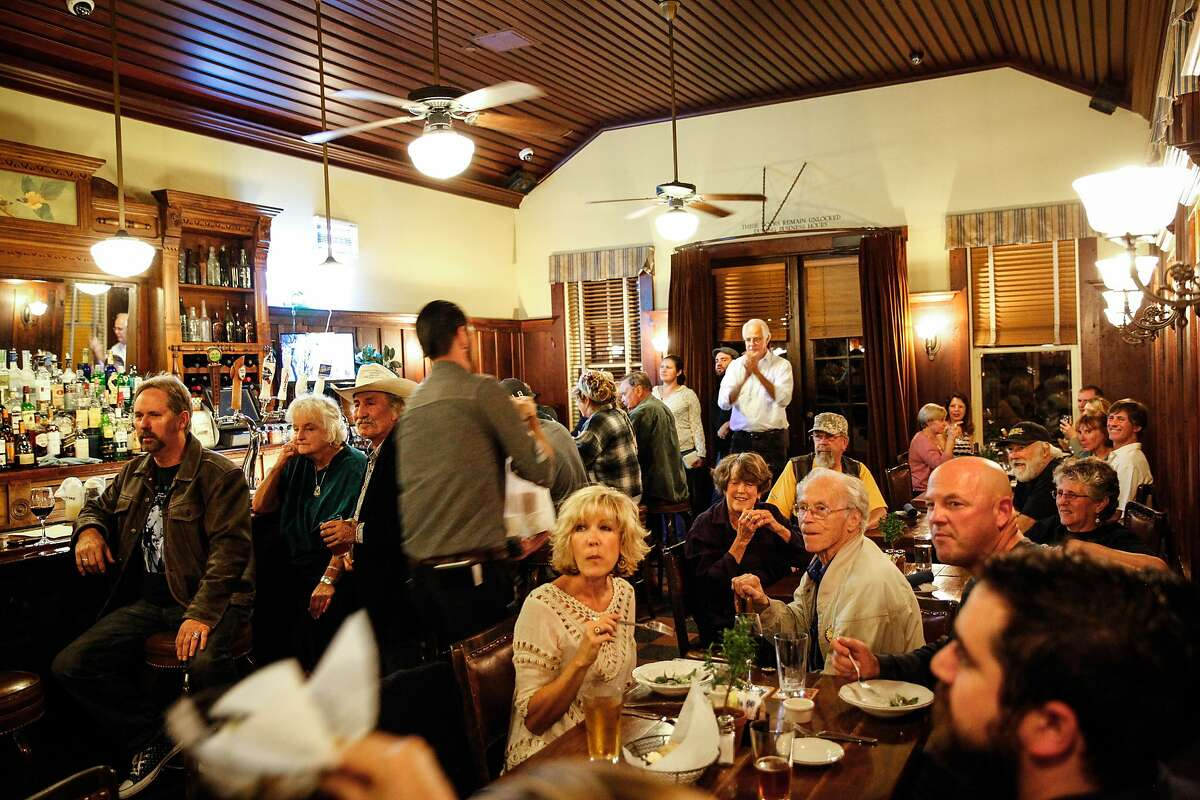 Guests listen to the music of CCB at Blues Night at the Blue Wing in Upper Lake, Calif., Monday, October 26, 2015.