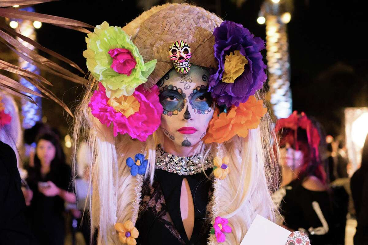 Fashion Week San Antonio kicked off with a colorful crowd on Sunday, November 1, 2015, with a Día de los Muertos masquerade party.