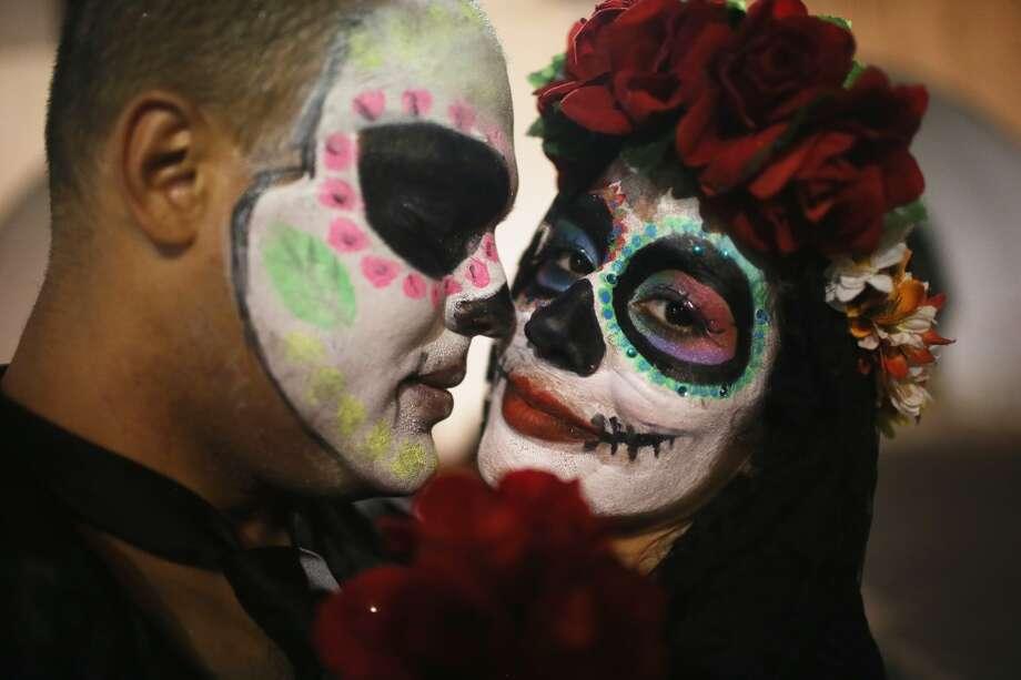 BrazilRio de JaneiroRevelers look on while posing during a Day of the Dead party on November 1, 2015 in Rio de Janeiro, Brazil. Photo: Mario Tama, Getty Images