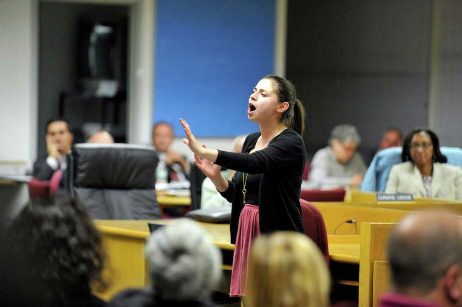 """Westhill High School student Juliana Goldfuss, who stars as Ariel in the All-School Musical performance of """"The Little Mermaid,"""" gives a preview before last week's Board of Education meeting. The show will be staged at Westhill in December. For tickets or information, visit stamfordallschoolmusical.org/home Photo: Michael Cummo / Hearst Connecticut Media / Stamford Advocate"""