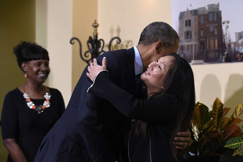 President Obama embraces Sharon Boatwright at Integrity House, a rehab facility in Newark, N.J. Photo: Susan Walsh, Associated Press