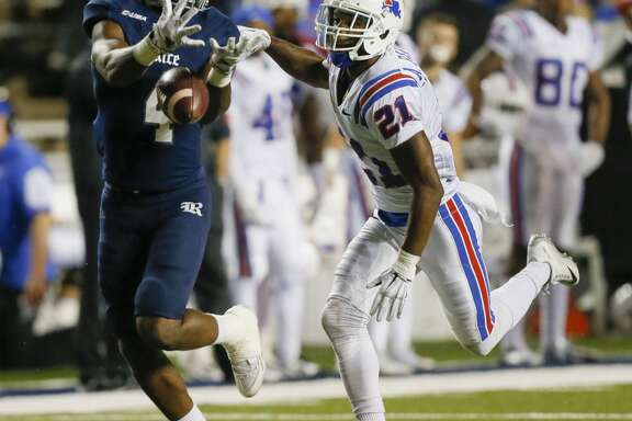 Rice Owls wide receiver Dennis Parks (4) has the ball go through his hands as he gets behind Louisiana Tech Bulldogs cornerback Adairius Barnes (21) during a NCAA Conference USA football game Friday, Oct. 30, 2015. (Bob Levey/For The Chronicle)