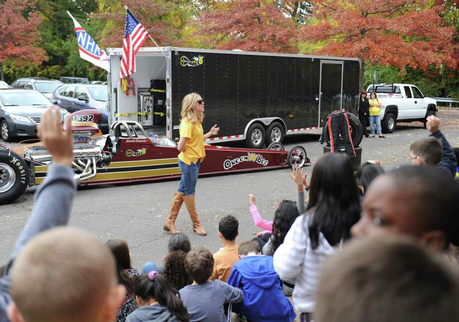 NHRA drag racer Sarah Edwards shows her top dragster vehicle to students at Julia A. Stark Elementary School. Edwards, a Stark School alumna and Stamford native, talked about her racing career and the science and aerodynamics of racing to a group of fourth-grade science students before letting the students get a close up look at her 1100 horsepower vehicle. Photo: Tyler Sizemore / Hearst Connecticut Media / Greenwich Time