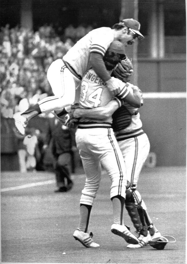 The A's Sal Bando and catcher Dave Duncan greet Rollie Fingers on the mound after the A's won the 1972 World Series.