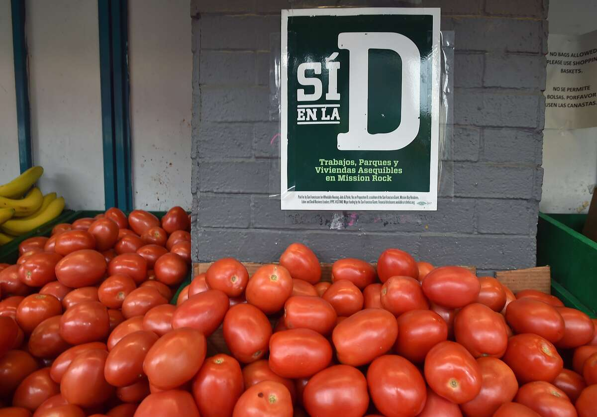 A sign supporting prop D is displayed outside a grocery store in the Mission district of San Francisco on November 02, 2015.