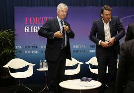 Best Buy CEO Hubert Joly (middle) and  CEO Gavin Patterson (right) of BT Group PLC leave after they speak on a panel at the Fortune Global Forum in the Fairmont Hotel in San Francisco, Calif., on Monday, November 2, 2015.