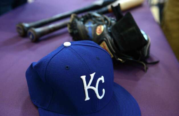 A baseball hat worn in Sunday?s World Series game by Wade Davis, bats from Alcides Escobar and Mike Moustakas and a glove from MVP catcher Salvador Perez of the Kansas City Royals are displayed to the media at Albany International Airport before being taken to the National Baseball Hall of Fame and Museum in Cooperstown Monday afternoon, Nov. 2, 2015, in Colonie, N.Y. Brad Horn, vice president of communications for the Hall of Fame, drove the items up from New York following Sunday?s game against the New York Mets. A jersey from Eric Hosmer is also promised. (Will Waldron/Times Union) Photo: Will Waldron / 00034047A