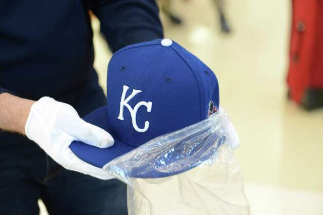Brad Horn of the National Baseball Hall of Fame and Museum displays a hat worn by Wade Davis of the Kansas City Royals during Sunday?s World Series ending game Monday afternoon, Nov. 2, 2015, following a press conference at Albany International Airport in Colonie, N.Y. The hat and several other items were being transported to Cooperstown. (Will Waldron/Times Union) Photo: Will Waldron / 00034047A