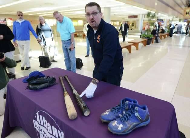 Brad Horn of the National Baseball Hall of Fame and Museum, points to a bat from Kansas City Royals? Alcides Escobar used in Sunday?s World Series ending game Monday afternoon, Nov. 2, 2015, during a press conference at Albany International Airport in Colonie, N.Y. The bat and several other items were being transported to Cooperstown. (Will Waldron/Times Union) Photo: Will Waldron / 00034047A