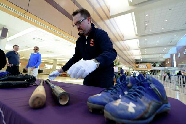 Brad Horn of the National Baseball Hall of Fame and Museum displays World Series memorabilia from the Kansas City Royals used in Sunday?s World Series ending game Monday afternoon, Nov. 2, 2015, during a press conference at Albany International Airport in Colonie, N.Y. (Will Waldron/Times Union) Photo: Will Waldron / 00034047A