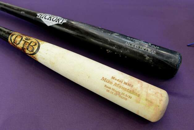 Baseball bats from Mike Moustakas and Alcides Escobar of the Kansas City Royals were part of a collection of World Series memorabilia heading to the National Baseball Hall of Fame and Museum which were displayed to the media Monday afternoon, Nov. 2, 2015, at Albany International Airport in Colonie, N.Y. Brad Horn of the Hall of Fame, drove the items up from New York following Sunday?s series ending game against the New York Mets. A jersey from Eric Hosmer is also promised. (Will Waldron/Times Union) Photo: Will Waldron / 00034047A