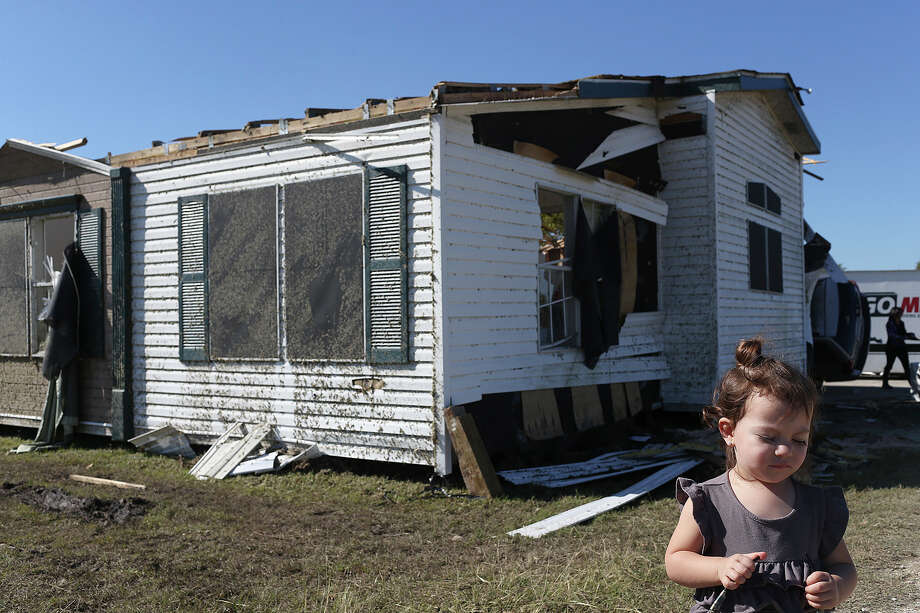 Amoura Alvarez, 2, plays near her damaged home in Geronimo, which was struck by one of four tornadoes in the area Friday. Photo: Jerry Lara /San Antonio Express-News / © 2015 San Antonio Express-News