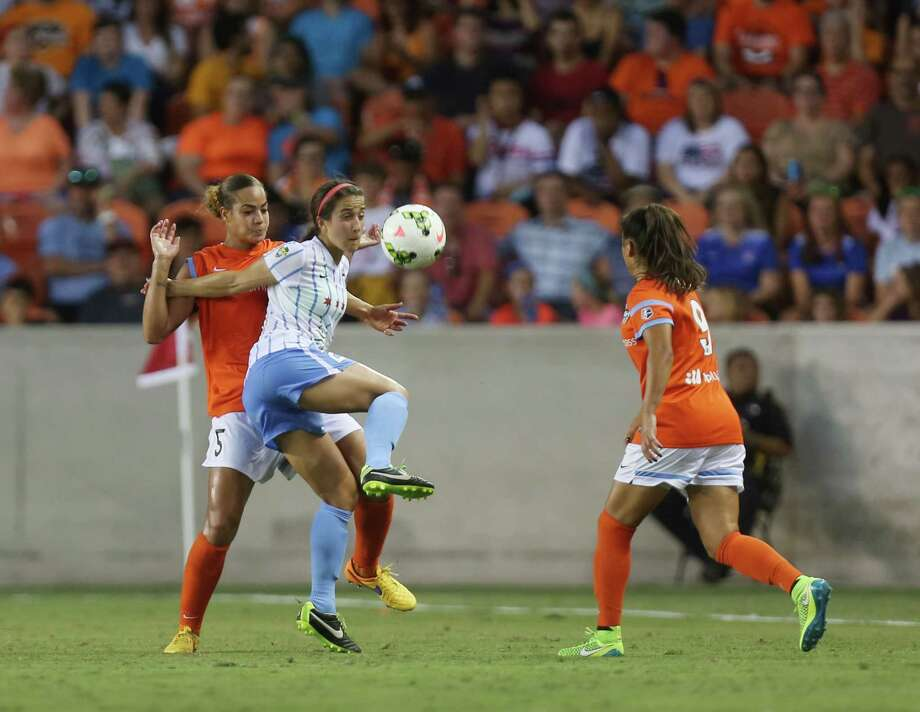 Chicago Red Stars forward Jennifer Hoy (2) fights with Houston Dash defender Toni Pressley and Houston Dash forward Stephanie Roche (9) during the first half of the Houston Dash vs. Chicago Red Stars game at BBVA Compass Stadium Sunday, July 12, 2015, in Houston. Photo: Jon Shapley, Houston Chronicle / © 2015 Houston Chronicle