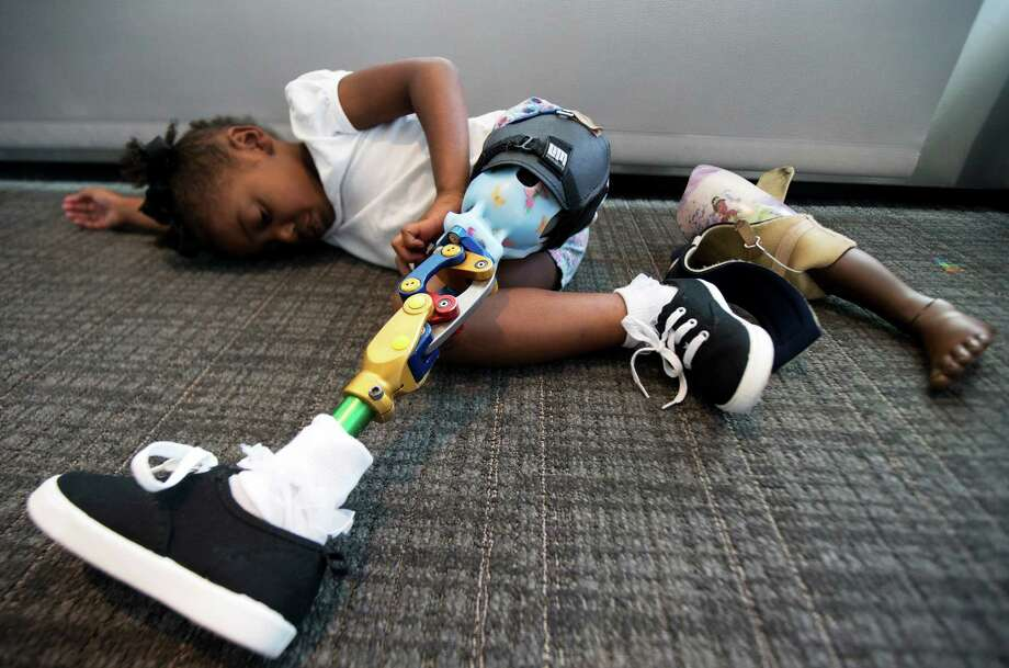 Miyah Williams, 3, wearing her new prosthetic leg, rests after showing how it allows her to play and dance.  Photo: Manuel Balce Ceneta /Associated Press / AP