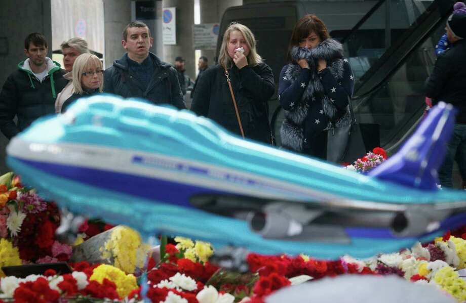 People grieve at a makeshift memorial at Pulkovo airport outside St. Petersburg, Russia. Photo: Dmitry Lovetsky /Associated Press / AP