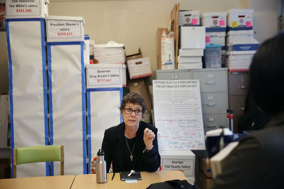 Shelia Tully ( to r), president of the California Faculty Association Chapter President, San Francisco talks with Students for  Quality Education intern Shannon Jose (partially seen at right)  in the faculty union office on Monday, November 2,  2015 in San Francisco, Calif. Photo: Lea Suzuki, The Chronicle