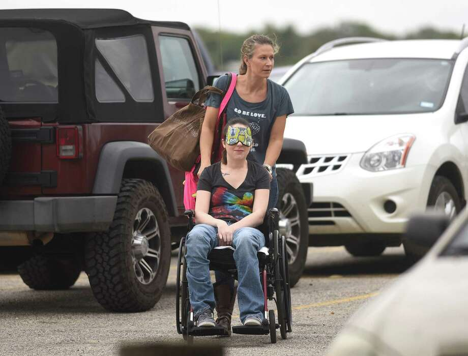 """Sara Gabel, who lives with muscular dystrophy, is blindfolded as her friend, Dawn Solinski, wheels her into Skydive San Marcos so that Gabel could have a wish come true, on Thursday, Oct. 29, 2015. Gabel had mentioned to Solinski that one remaining item on her """"bucket list"""" was to skydive. Unknown to Gabel, Solinski arranged for her wish to come true. One hour earlier, Solinski had picked up Gabel under the guise of taking her to lunch. Photo: Billy Calzada /San Antonio Express-News / San Antonio Express-News"""