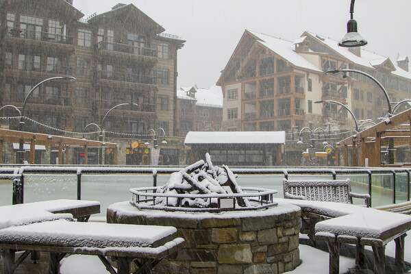 In this photo provided by Northstar California, snow falls on The Village at Northstar ski resort Monday, Nov. 2, 2015, in Truckee, Calif. The first winter-like storm of the season brought rain and snow to California on Monday, triggering traffic accidents including a several vehicle crash in the southern San Joaquin Valley. (Northstar California via AP)