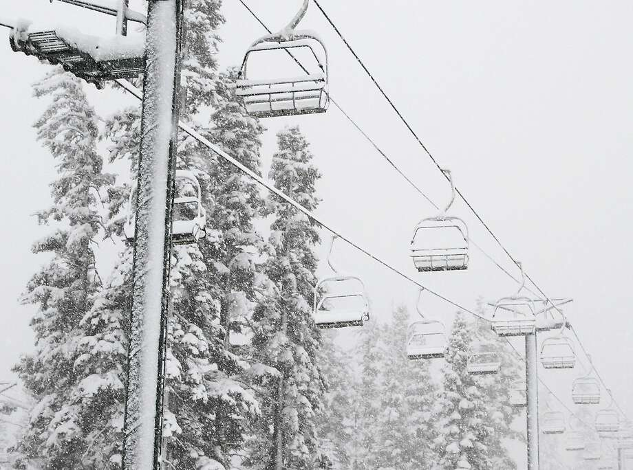 In this photo provided by Kirkwood Mountain Resort, snow falls on lifts at the Kirkwood ski resort Monday, Nov. 2, 2015, in Kirkwood, Calif. The first winter-like storm of the season brought rain and snow to California on Monday, triggering traffic accidents including a several vehicle crash in the southern San Joaquin Valley. (Kirkwood Mountain Resort via AP) Photo: Associated Press