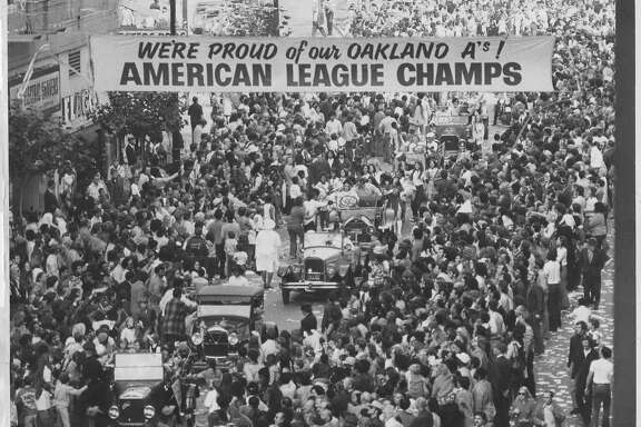 Oakland Athletics   A's World Series victory parade in downtown Oakland.  According to the back of the photo, Stephanie Maze was a freelancer when she took this photo. Would be hired full-time Feb. 20, 1973.  Photo was taken: 10/23/1972.