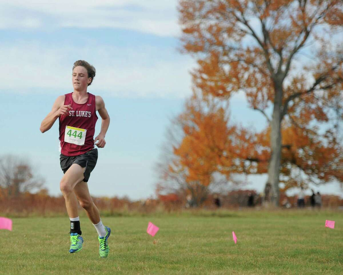 St. Luke's School's Will Foster runs in the Fairchester Athletic Association (FAA) high school cross country championships at Waveny Park in New Canaan, Conn. Monday, Nov. 2, 2015. Brunswick School won the boys team championship and School of the Holy Child won the girls team championship.