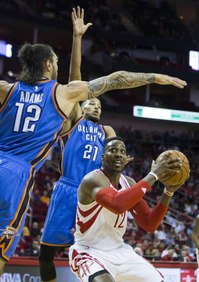 Oklahoma City Thunder center Steven Adams (12) and guard Andre Roberson (21) defend a shot by Houston Rockets center Dwight Howard (12) during the first half of an NBA basketball game at Toyota Center Monday, Nov. 2, 2015, in Houston. ( Brett Coomer / Houston Chronicle ) Photo: Brett Coomer, Houston Chronicle
