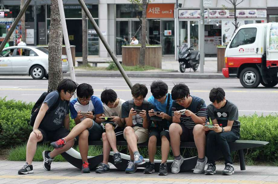 More phonesAround the world, more people have mobile phones than toilets. Photo: Ahn Young-joon, STF / AP