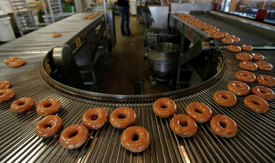 Krispy Kreme doughnuts were ready to eat at a Houston location in 2006. The chain is back in the Houston area with plans for at least four locations.  Photo: KAREN WARREN, STAFF / Houston Chronicle