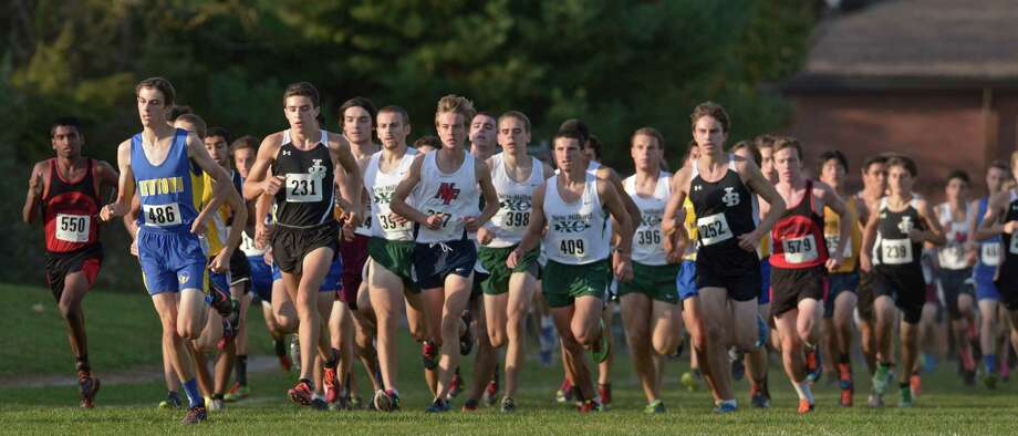 Runners cross a field during the boys SWC cross country championships, on Wednesday afternoon, October 21, 2015, held at Bethel High School, Bethel, Conn. Photo: H John Voorhees III / Hearst Connecticut Media / The News-Times