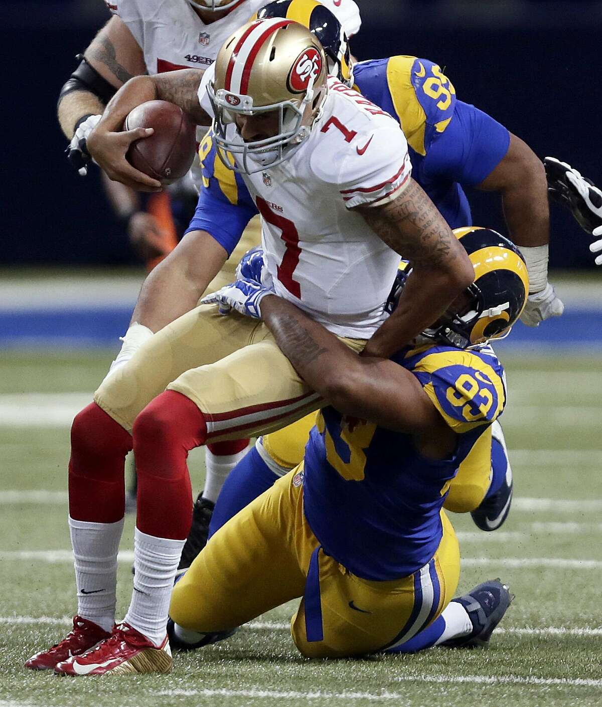 San Francisco 49ers quarterback Colin Kaepernick (7) is sacked for a 3-yard loss by St. Louis Rams defensive tackle Ethan Westbrooks during the fourth quarter of an NFL football game, Sunday, Nov. 1, 2015, in St. Louis.