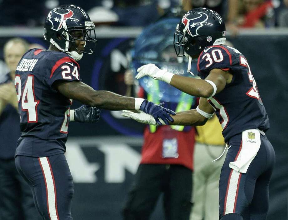 Even though the Texans are 3-5, cornerback Johnathan Joseph (24) and strong safety Kevin Johnson (30) have reason to be excited since the team remains in the AFC South title hunt. Photo: Brett Coomer, Staff / © 2015  Houston Chronicle