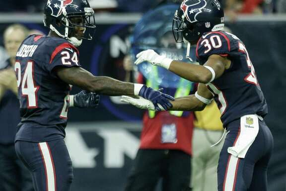 Even though the Texans are 3-5, cornerback Johnathan Joseph (24) and strong safety Kevin Johnson (30) have reason to be excited since the team remains in the AFC South title hunt.