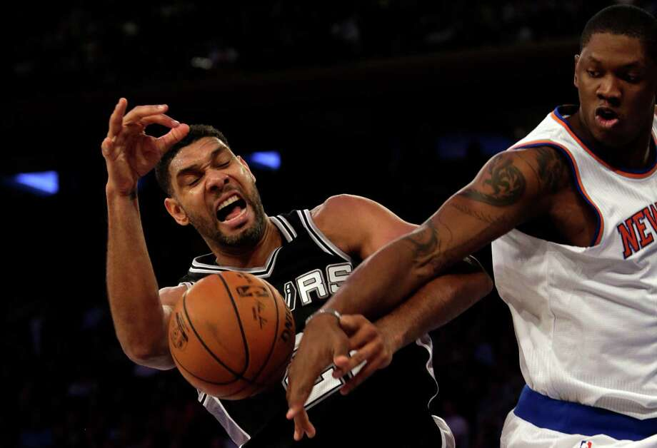 NEW YORK, NY - NOVEMBER 2: Tim Duncan #21 of the San Antonio Spurs is fouled by Kevin Seraphin #1 of the New York Knicks during the second half at Madison Square Garden on November 2, 2015 in New York City. The Spurs defeated the Knicks 94-84. (Photo by Adam Hunger/Getty Images) Photo: Adam Hunger, Stringer / Getty Images / 2015 Getty Images