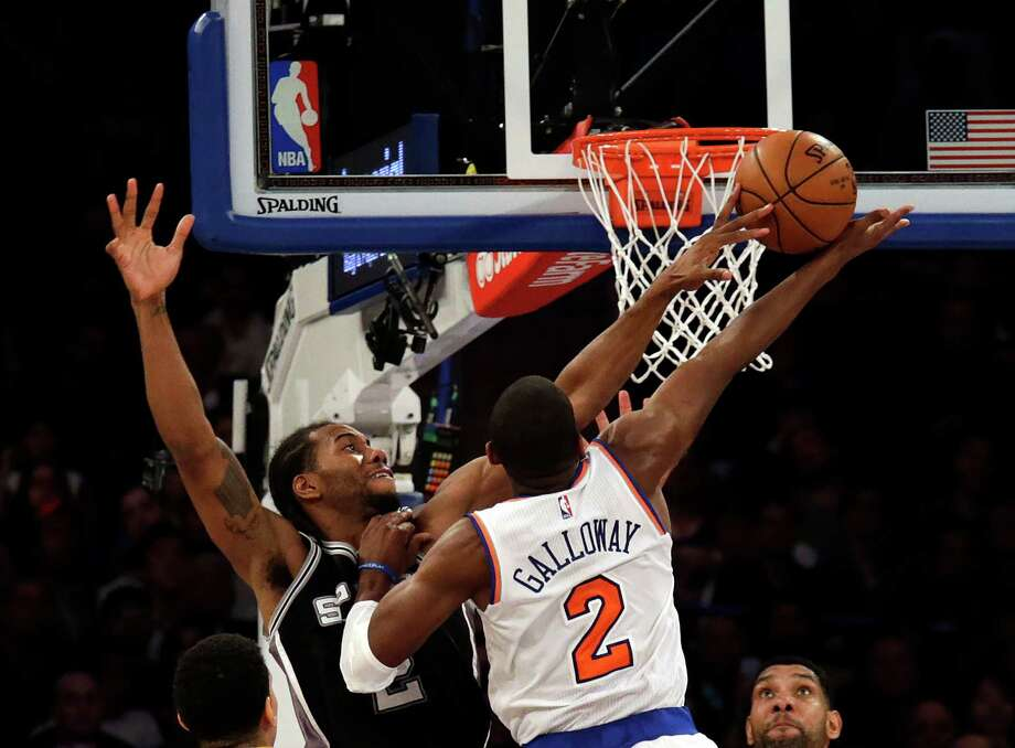 NEW YORK, NY - NOVEMBER 2: Kawhi Leonard #2 of the San Antonio Spurs blocks a shot by Langston Galloway #2 of the New York Knicks during the second half at Madison Square Garden on November 2, 2015 in New York City. The Spurs defeated the Knicks 94-84. (Photo by Adam Hunger/Getty Images) Photo: Adam Hunger, Stringer / Getty Images / 2015 Getty Images