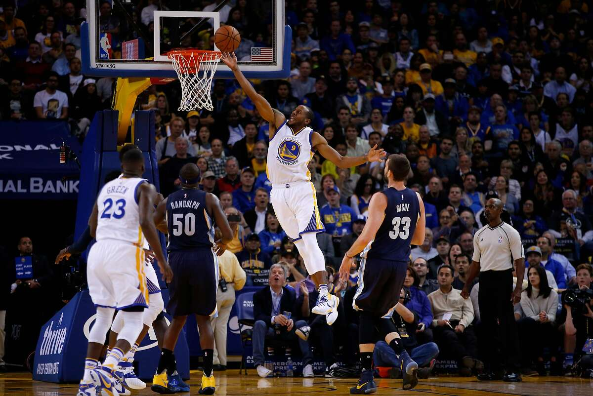 Andre Iguodala of the Golden State Warriors goes up for a shot on Zach Randolph and Marc Gasol of the Memphis Grizzlies at ORACLE Arena on November 2, 2015 in Oakland, California.