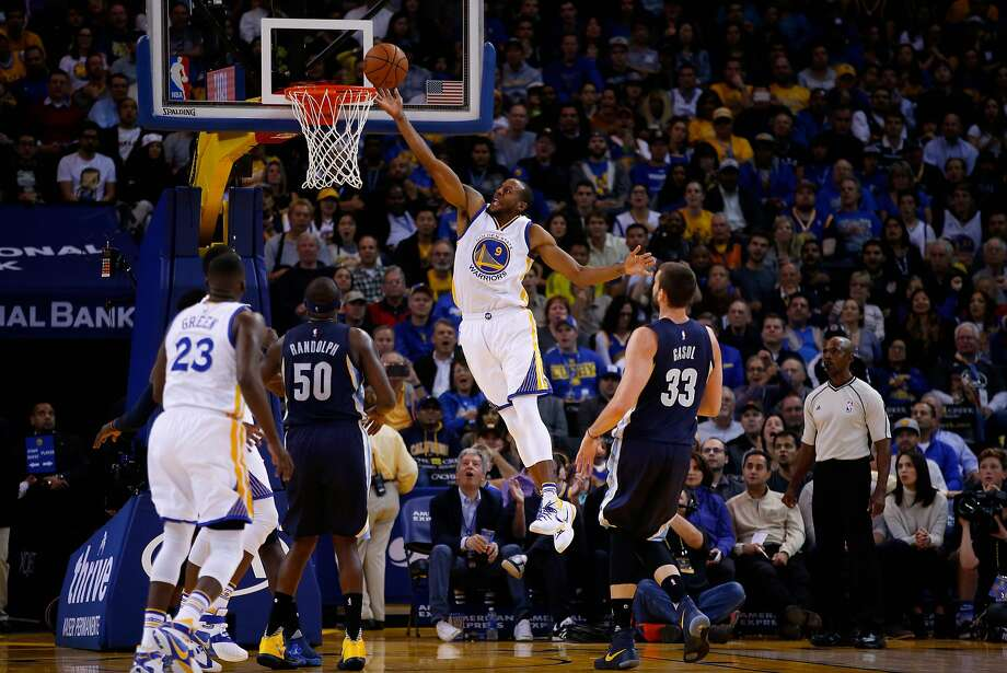 Andre Iguodala of the Golden State Warriors goes up for a shot on Zach Randolph and Marc Gasol of the Memphis Grizzlies at ORACLE Arena on November 2, 2015 in Oakland, California. Photo: Ezra Shaw, Getty Images
