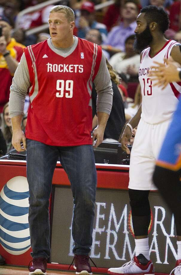 J.J. Watt at Rockets gamesHouston Texans defensive end J.J. Watt, left, acts like he is going into the game with Houston Rockets guard James Harden (13) during the second half of an NBA basketball game against the Oklahoma City Thunder at Toyota Center Monday, Nov. 2, 2015, in Houston. ( Brett Coomer / Houston Chronicle ) Photo: Houston Chronicle