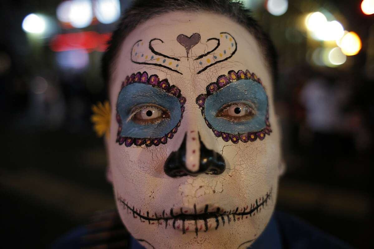 Rogelio Lemus of Stockton poses with his face paint on during a Day of the Dead celebration in the Mission district in San Francisco, Calif., on Monday, November 2, 2015.