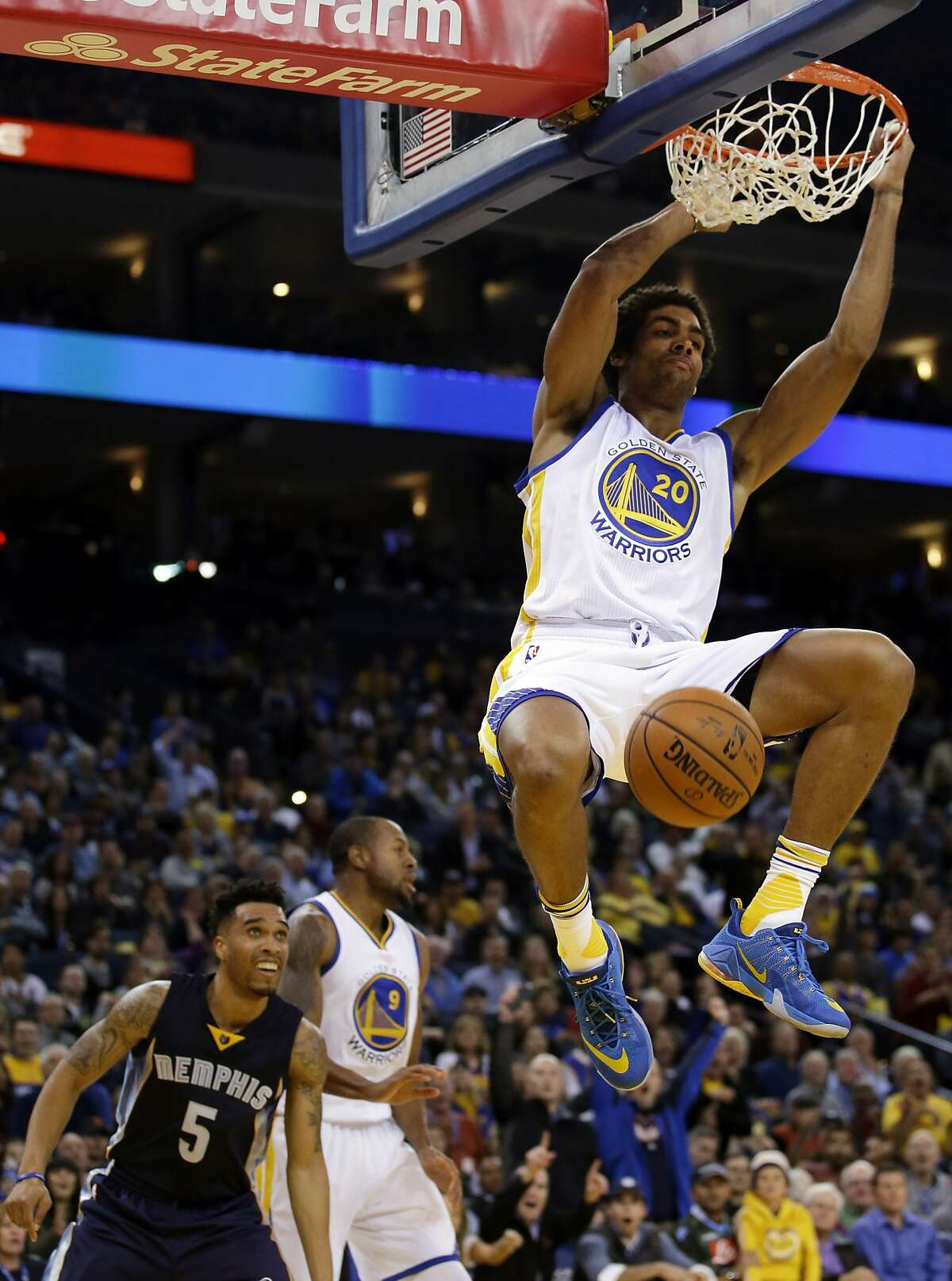 Golden State Warriors' James Michael McAdoo (20) dunks against the Memphis Grizzlies during the second half of an NBA basketball game Monday, Nov. 2, 2015, in Oakland, Calif.